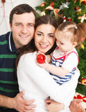 Happy family with near the Christmas tree Royalty Free Stock Photo