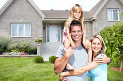 Happy family near new house. Royalty Free Stock Images