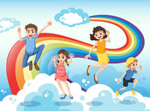 A happy family near the rainbow Stock Images