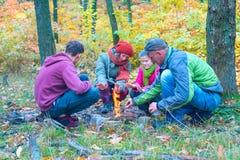 Happy family near a small bonfire stock photography