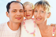 Happy family near to sea, concerning with heads Royalty Free Stock Image