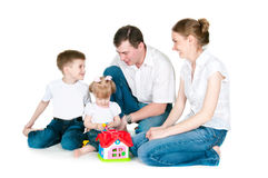 Happy family near a toy small house Royalty Free Stock Photography
