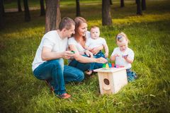 Happy family with nesting box and paints Royalty Free Stock Photo