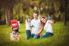 Happy family with nesting box and paints Stock Images