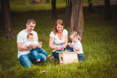 Happy family with nesting box and paints Royalty Free Stock Photography