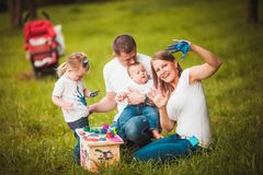 Happy family with nesting box and paints Stock Photography