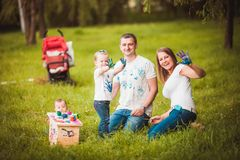 Happy family with nesting box and paints Stock Photo