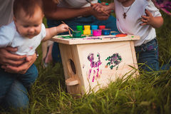Happy family with nesting box and paints Stock Photos