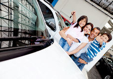 Happy family with new car Stock Image