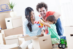 Happy Family In New Home. Young happy family relaxing after they have moved into their new home Royalty Free Stock Photos