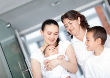 Happy family with a newborn Royalty Free Stock Photos