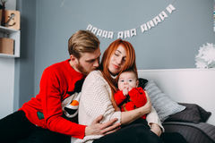 Happy family with newborn baby on the bed Royalty Free Stock Image