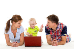 Happy family with notebook. Stock Images