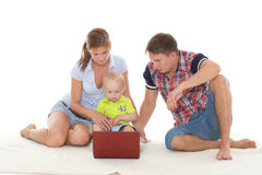 Happy family with notebook. Royalty Free Stock Image