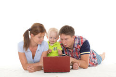 Happy family with notebook. Royalty Free Stock Photography