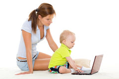 Happy family with notebook. Stock Photo