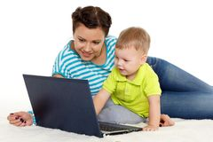 Happy family with notebook. Royalty Free Stock Photos