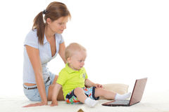 Happy family with notebook. Stock Photography