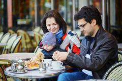 Free Happy Family Of Three In Parisian Outdoor Cafe Royalty Free Stock Images - 107289559
