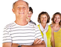 Happy family, old man in focus. Happy family with old man in focus, arms folded isolated against the white background royalty free stock photography