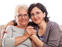 Happy family old woman and adult daughter Stock Photos