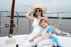 Happy family onboard the yacht. Stock Photo