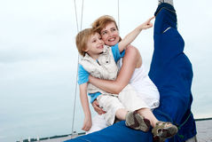 Happy family onboard the yacht. Stock Photography