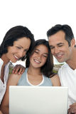 Happy Family with one child using laptop Royalty Free Stock Image