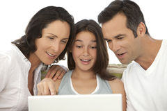 Happy Family with one child using laptop stock photos