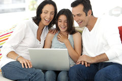 Happy Family with one child using laptop Stock Photo
