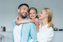 happy family with one kid hugging and spending time together royalty free stock images