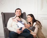 Happy family with one year old baby girl indoor Royalty Free Stock Images