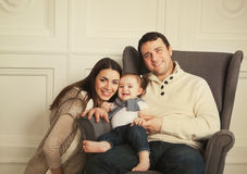 Happy family with one year old baby girl indoor Stock Photo