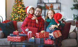 Happy family open presents on Christmas morning stock photography