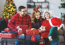 Happy family open presents on Christmas morning royalty free stock photos