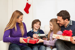 Happy family opening the christmas gift Royalty Free Stock Photo