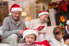 Happy family opening christmas gifts together Royalty Free Stock Photography