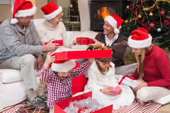 Happy family opening christmas gifts together Royalty Free Stock Photos