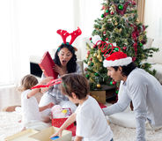 Happy family opening Christmas presents stock photos
