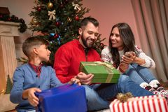 Family with christmas presents royalty free stock image