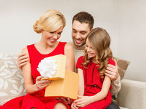 Happy family opening gift box. Family, christmas, x-mas, winter, happiness and people concept - happy family opening gift box Stock Photography