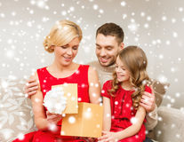 Happy family opening gift box Stock Photos