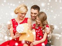 Happy family opening gift box Stock Photo