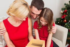 Happy family opening gift box Stock Photo