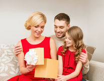 Happy family opening gift box Royalty Free Stock Images