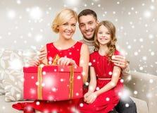 Happy family opening gift box Stock Image