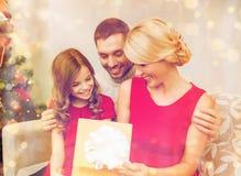 Happy family opening gift box Royalty Free Stock Photo