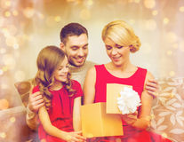 Happy family opening gift box Stock Images