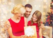 Happy family opening gift box Royalty Free Stock Image