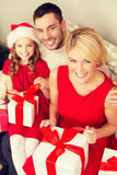 Happy family opening gift boxes Stock Photo